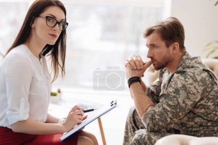 psychologist sitting in office with client