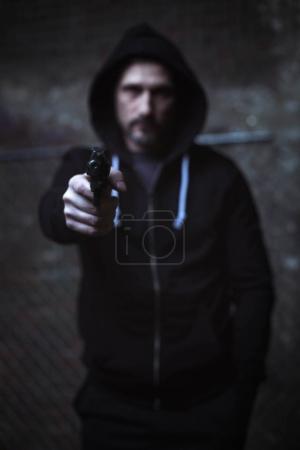 Dangerous criminal holding a weapon