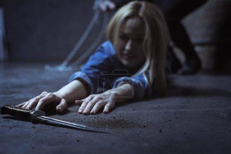Girl trying reaching knife