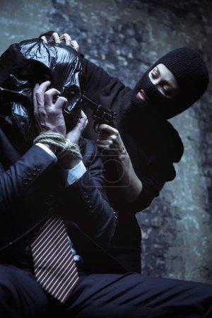 Mad abductor threatening killing man