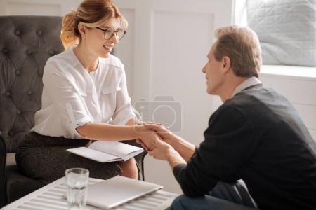 man smiling and looking at psychologist