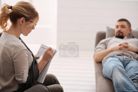therapist putting preliminary diagnosis