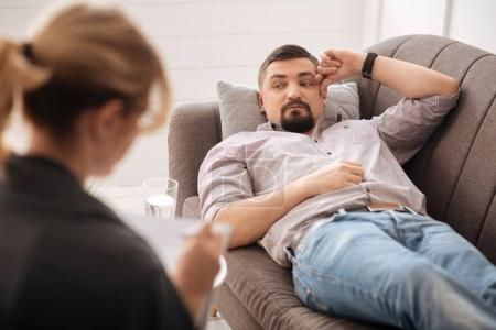 man undergoing psychological treatment