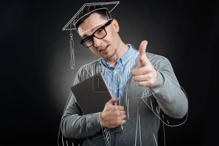 Delighted graduate pointing you