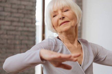 Elderly woman performing in ballroom