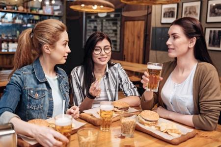 Company of close friends sitting in pub