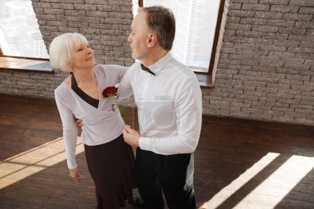 Passionate senior couple tangoing in the dance studio