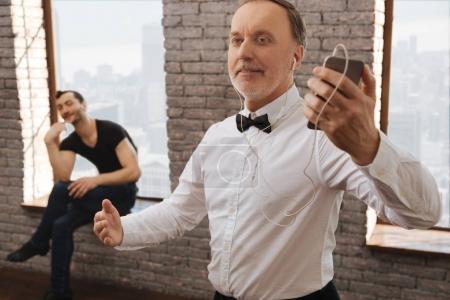 Delighted pensioner enjoying music in the dance studio