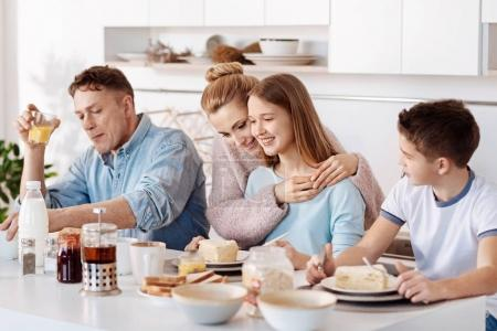 Pleasant family having breakfast in the kitchen