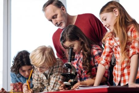 Admirable professional teacher assisting his students