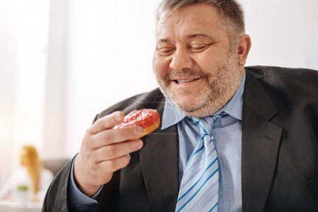 Delighted hungry worker happy to have some sweets