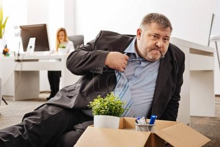 Stressed out fired employee being shocked