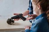 Handgun being in hands of a man