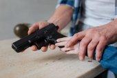 Handgun being in hands of a young girl