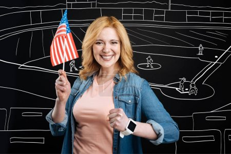 Cheerful woman supporting her american