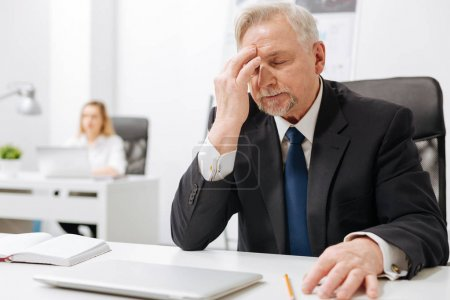 Upset businessman expressing despair in the office