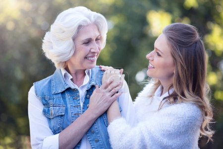 woman enjoying with retired mother in park
