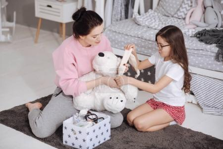 Involved mother and daughter enjoying games at home