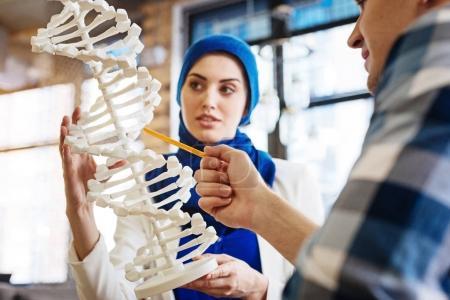 Smart international students learning genetics