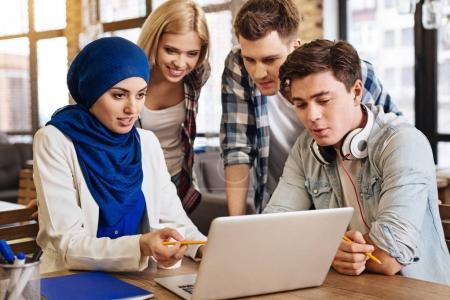 Involved international students learning together
