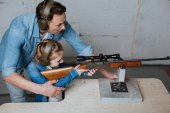 Nice delighted man having a lesson with his daughter