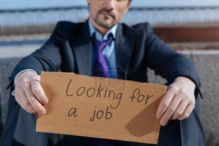 Close up of jobless man looking for new work