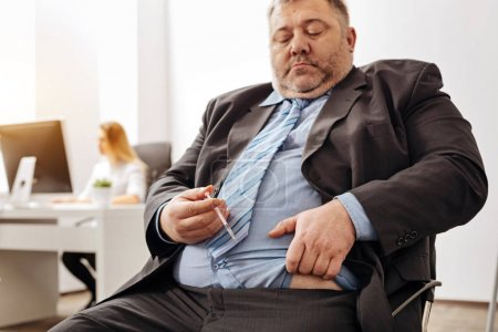 Overweight office worker having health issues