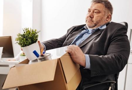 Distressed shocked employee looking hopeless