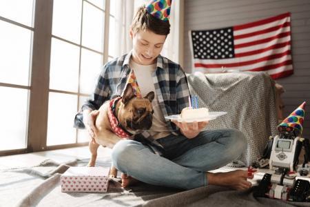 Amazing teenager celebrating with his dog