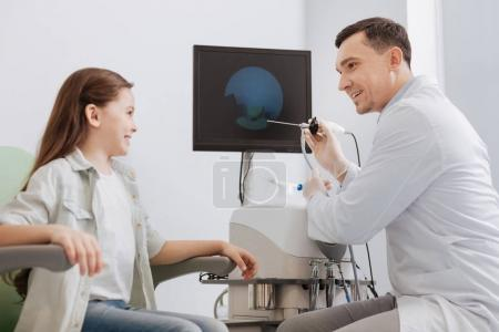 Positive otolaryngologist holding ENT instrument