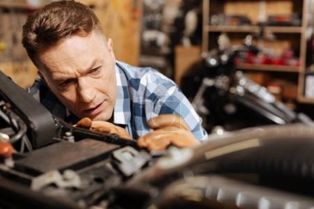 Skillful amateur mechanic making his bike perfect