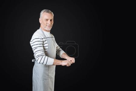 Smiling cook imagining that pushing food cart