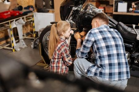 Adorable family fixing the engine together