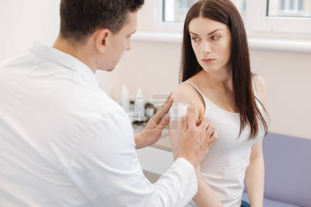Sad unhappy woman receiving medical help