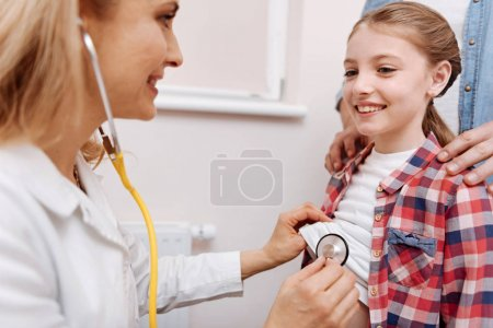 Portrait of smiling little patient looking at her doctor