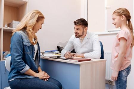 Enigmatical woman sitting in consulting room