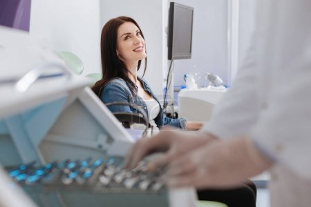 Happy woman looking at her doctor