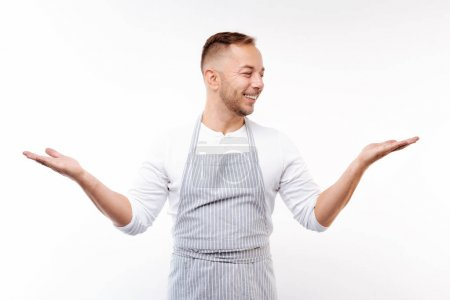 Upbeat man posing on white background with spread hands