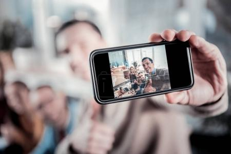 Photo for Photo to memory. Joyful pleasant creative company having fun posing and making photo. - Royalty Free Image