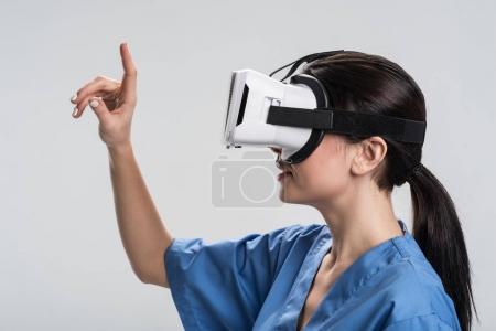 Pensive female doctor seizing virtual  table
