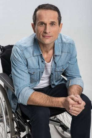 Appealing disabled man posing in wheelchair