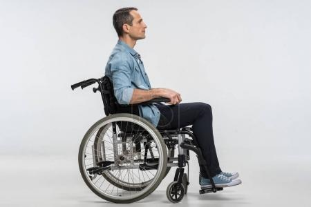 Good looking  crippled man resting in wheelchair