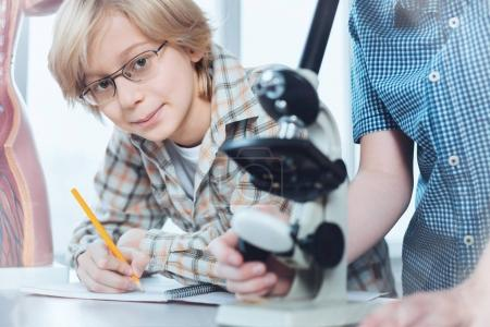 Analytical intelligent kid writing down obtained data