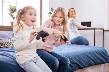 Excited young girls playing a game