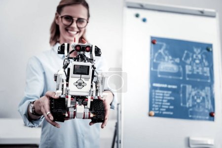 Focused picture on robot that being in female hands