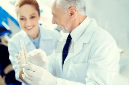 Laboratory workers discussing test sample in lab