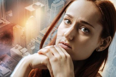 Stressful sad woman sitting and feeling bad herself.