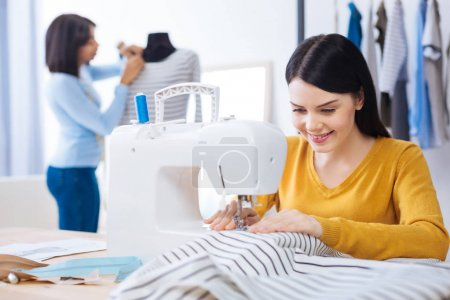 Young women working in a professional atelier together