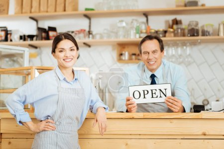 Pleasant friendly employees standing in the shop and smiling.