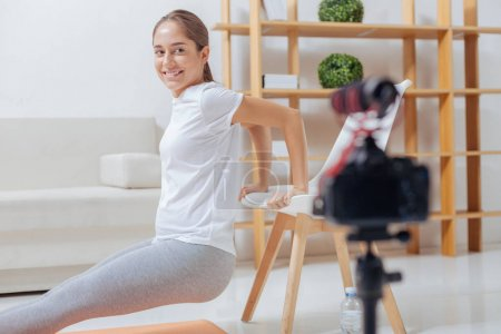 Emotional young woman feeling happy while recording her video lesson